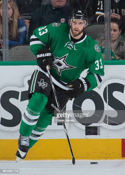Alex Goligoski of the Dallas Stars handles the puck against the New York Rangers at the American Airlines Center on December 29 2014 in Dallas Texas