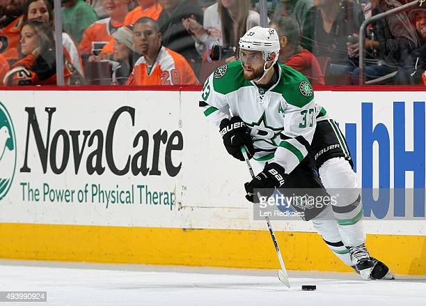 Alex Goligoski of the Dallas Stars skates the puck against the Philadelphia Flyers on October 20 2015 at the Wells Fargo Center in Philadelphia...