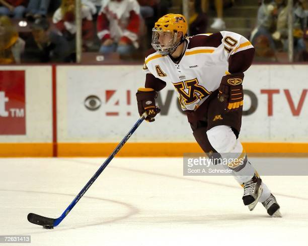 Alex Goligoski of the Minnesota Gophers carries the puck out of his zone against the Wisconsin Badgers on November 19 2006 at Mariucci Arena in...