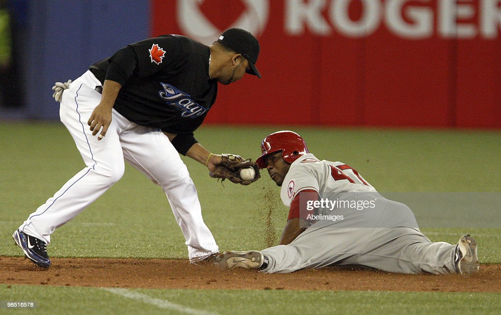 Alex Gonzales #11 of the Toronto Blue Jays misses the stolen base tag on Howard Kendrick #47 of the Los Angeles Angels during a MLB game at the Rogers Centre April 17, 2010 in Toronto, Ontario, Canada.