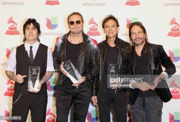 Alex Gonzalez Fher Olvera Juan Calleros and Sergio Vallin of Mana pose in the press room during the 19th annual Latin GRAMMY Awards at MGM Grand...