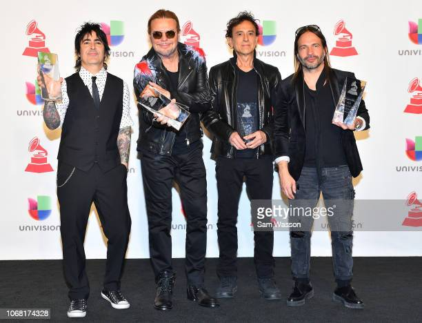 Alex Gonzalez Fher Olvera Juan Calleros and Sergio Vallin of Mana winners of Person of the Year pose in the press room during the 19th annual Latin...