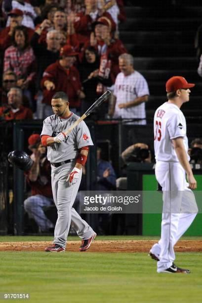 Alex Gonzalez of the Boston Red Sox reacts to striking out against starting pitcher Jered Weaver#36 of the Los Angeles Angels of Anaheim in Game Two...