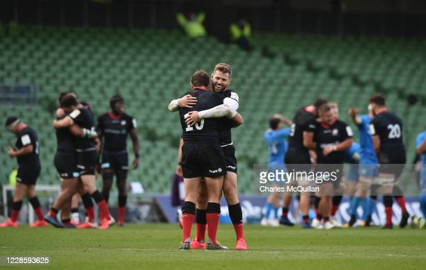 Alex Goode and Eliot Daly of Saracens celebrate after the Heineken Champions Cup Quarter Final match between Leinster and Saracens at Aviva Stadium...