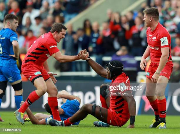 Alex Goode and Maro Itoje of Saracens celebrate winning the Champions Cup Final match between Saracens and Leinster at St James Park on May 11 2019...