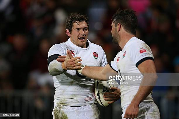 Alex Goode celebrates with Ben Foden both of England after scoring a try during the International Tour match between the Crusaders and England at AMI...