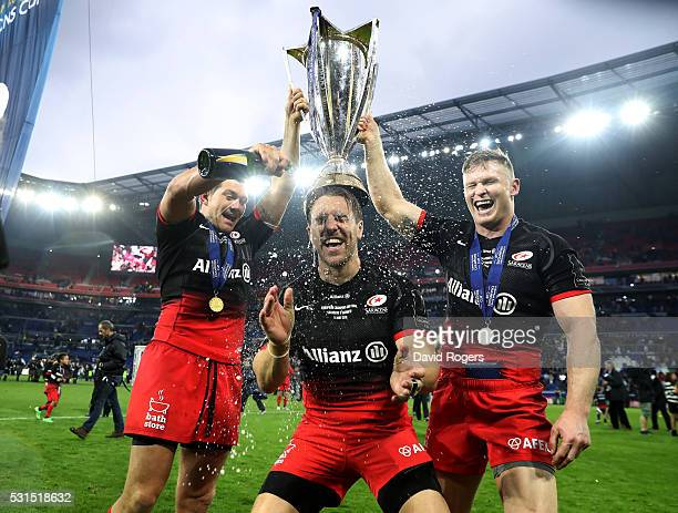 Alex Goode Chris Wyles and Chris Ashton of Saracens celebrate after their vicotry during the European Rugby Champions Cup Final match between Racing...