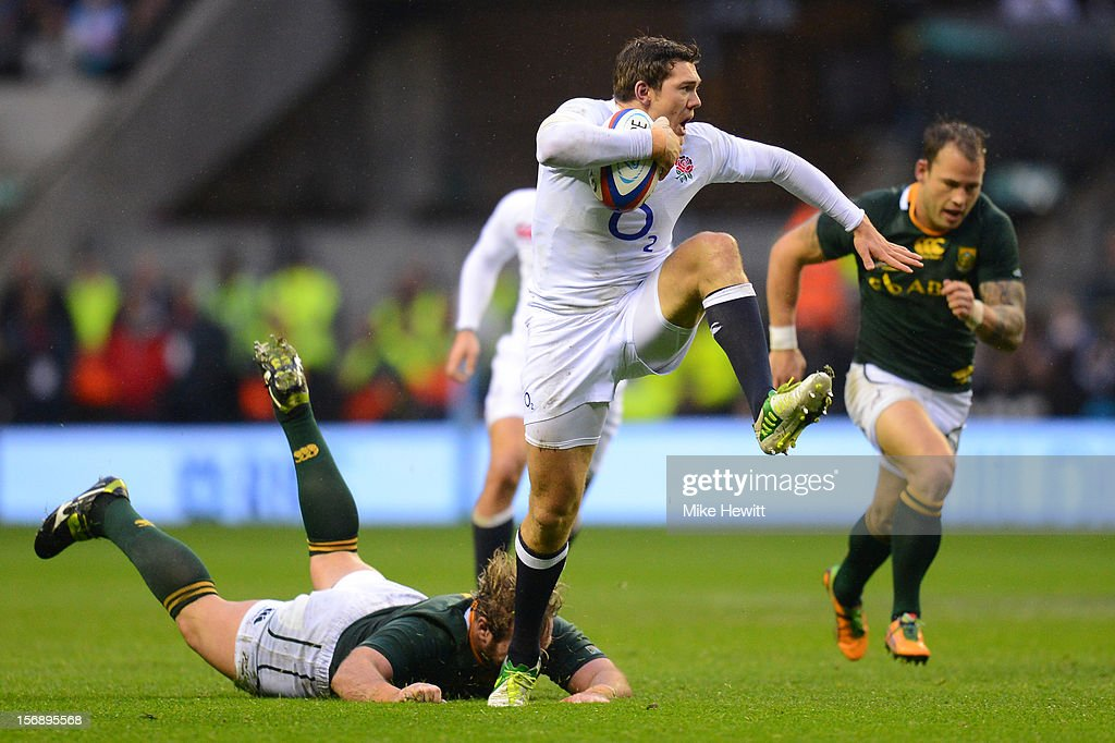 Alex Goode of England breaks away from Jannie du Plessis of South Africa during the QBE International match between England and South Africa at Twickenham Stadium on November 24, 2012 in London, England.