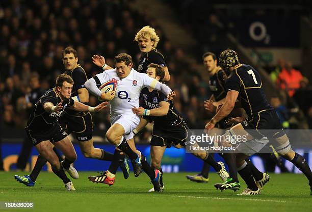 Alex Goode of England breaks through the Scottish defence during the RBS Six Nations match between England and Scotland at Twickenham Stadium on...