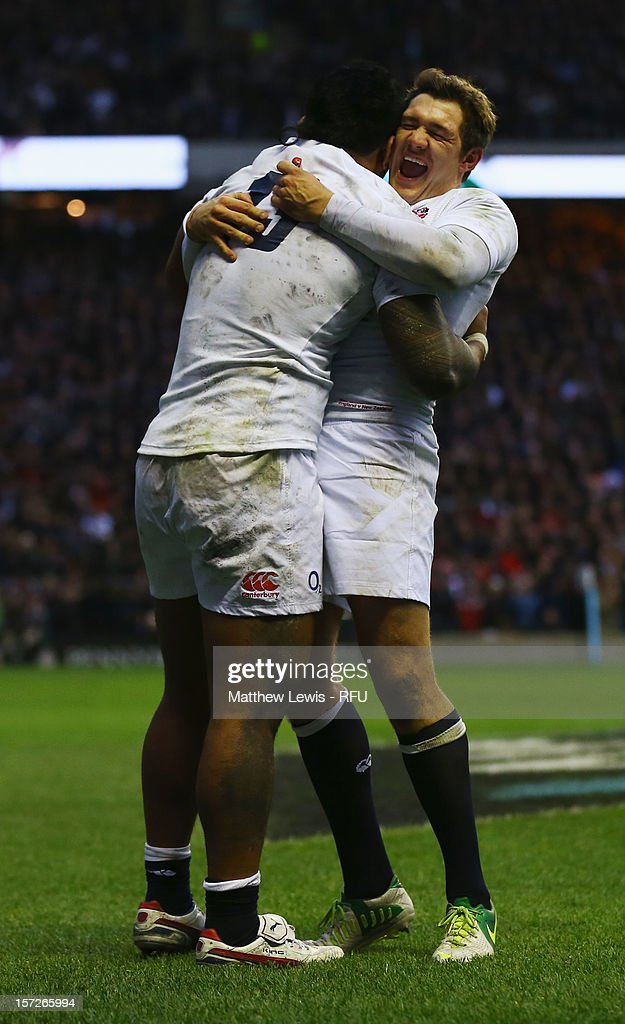 Alex Goode of England congratulates Manu Tuilagi of England on scoring his try during the QBE International match between England and New Zealand at Twickenham Stadium on December 1, 2012 in London, England.