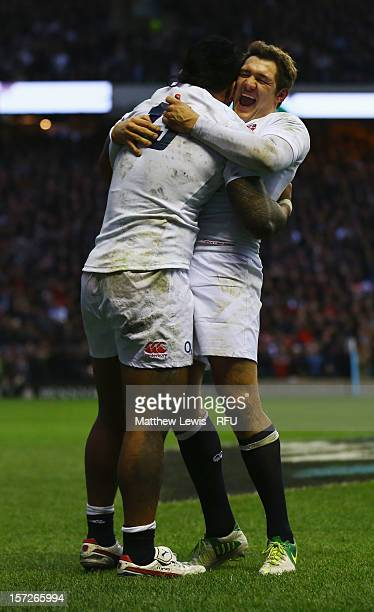 Alex Goode of England congratulates Manu Tuilagi of England on scoring his try during the QBE International match between England and New Zealand at...