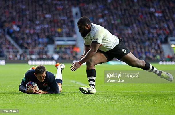 Alex Goode of England dives to score his team's sixth try during the Old Mutual Wealth series match between England and Fiji at Twickenham Stadium on...