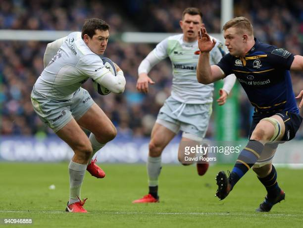 Alex Goode of Saracens breaks with th ball as Dan Leavy looks on during the European Rugby Champions Cup quarter final match between Leinster Rugby...