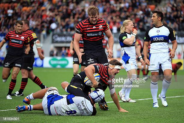 Alex Goode of Saracens dives over to score a try during the Aviva Premiership Rugby match between Saracens and Bath at the Allianz Park on September...