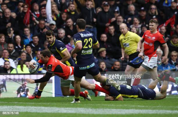 Alex Goode of Saracens dives over to score his team's third try during the European Rugby Champions Cup Final between ASM Clermont Auvergne and...