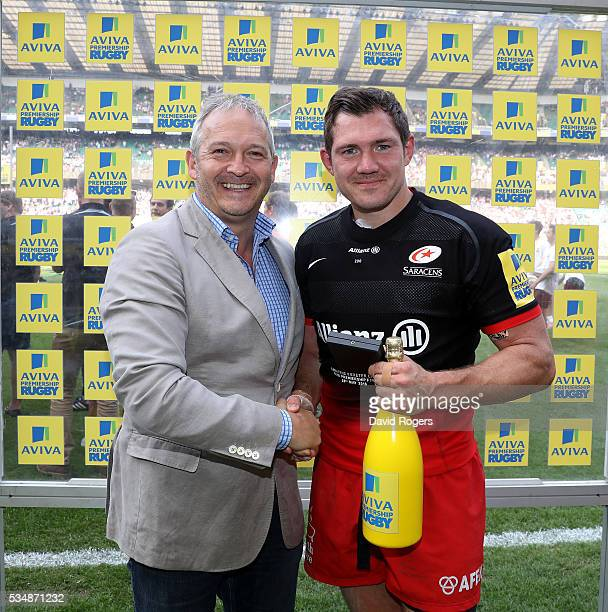 Alex Goode of Saracens is presented with the Peter Deakin medal as Man of the Match during the Aviva Premiership final match between Saracens and...