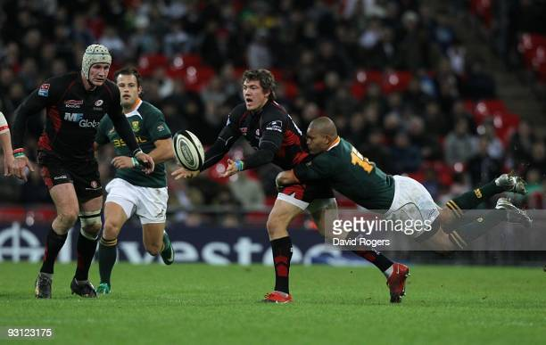 Alex Goode of Saracens is tackled by Earl Rose of South Africa during the friendly match between Saracens and South Africa at Wembley Stadium on...