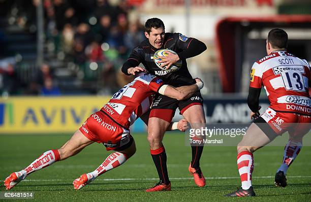 Alex Goode of Saracens is tackled by James Hook of Gloucester Rugby during the Aviva Premiership match between Saracens and Gloucester Rugby at...