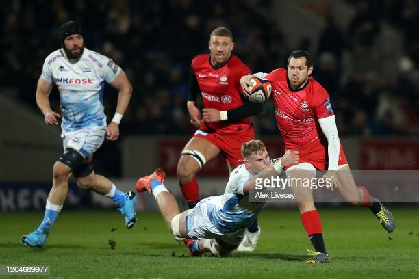 Alex Goode of Saracens is tackled by Jean Luc du Preez of Sale Sharks during the Premiership Rugby Cup SemiFinal match between Sale Sharks and...