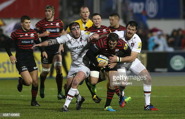 Alex Goode of Saracens is tackled by Matt Smith amd Neil Briggs during the Aviva Premiership match between Saracens and Leicester Tigers at Allianz...