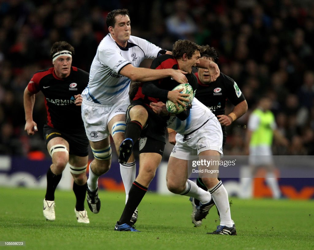 Alex Goode of Saracens is tackled by Shane Jennings and Devin Toner (L) during the Heineken Cup match between Saracens and Leinster at Wembley Stadium on October 16, 2010 in London, England.