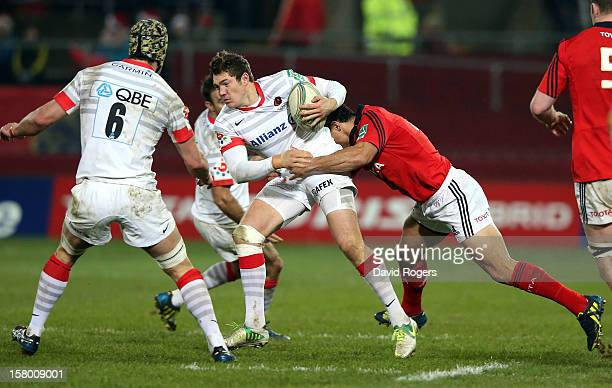 Alex Goode of Saracens is tackled during the Heineken Cup match between Munster and Saracens at Thomond Park on December 8 2012 in Limerick Ireland