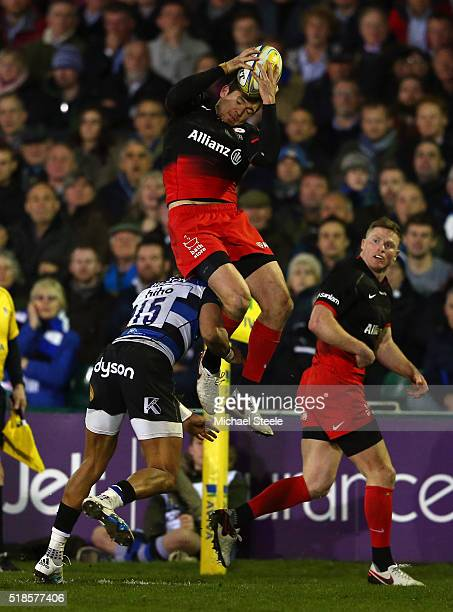 Alex Goode of Saracens is tackled in the air by Anthony Watson of Bath resulting in a red card during the Aviva Premiership match between Bath Rugby...