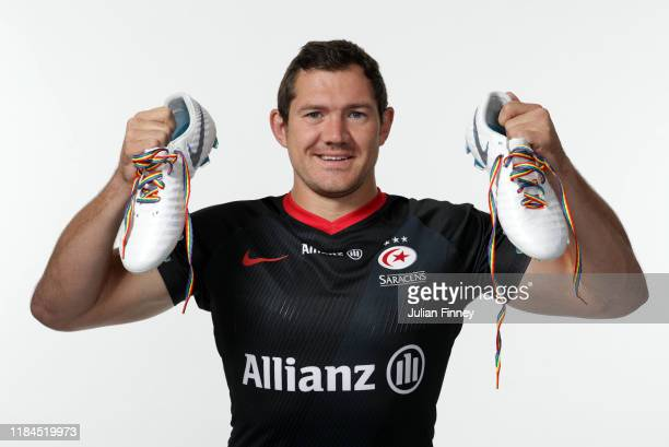 Alex Goode of Saracens poses for a portrait with rainbow laces on his boots in support of the Stonewall Rainbow Laces Campaign promoting equality and...