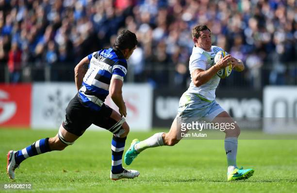 Alex Goode of Saracens takes on Francois Louw of Bath during the Aviva Premiership match between Bath Rugby and Saracens at Recreation Ground on...