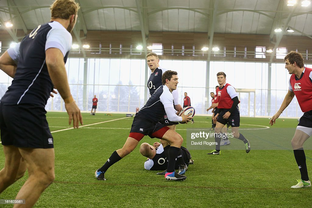 Alex Goode runs with the ball during the England training session held at St Georges Park on February 13, 2013 in Burton-upon-Trent, England.