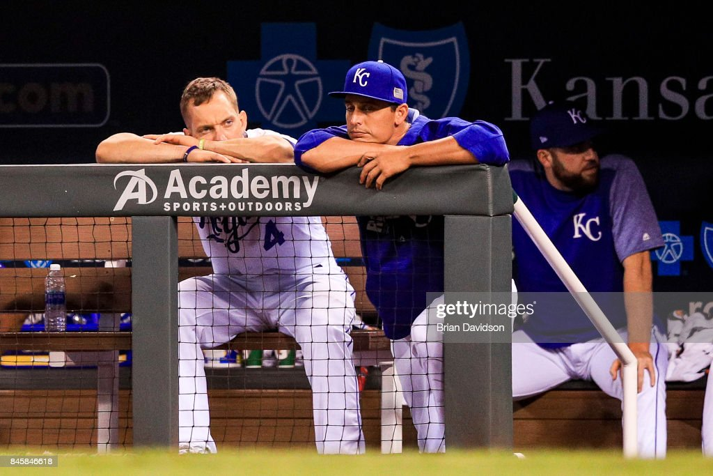 Alex Gordon #4 and Jason Vargas #51 of the Kansas City Royals sit in dejection in the dugout during ninth inning against the Chicago White Sox at Kauffman Stadium on September 11, 2017 in Kansas City, Missouri.