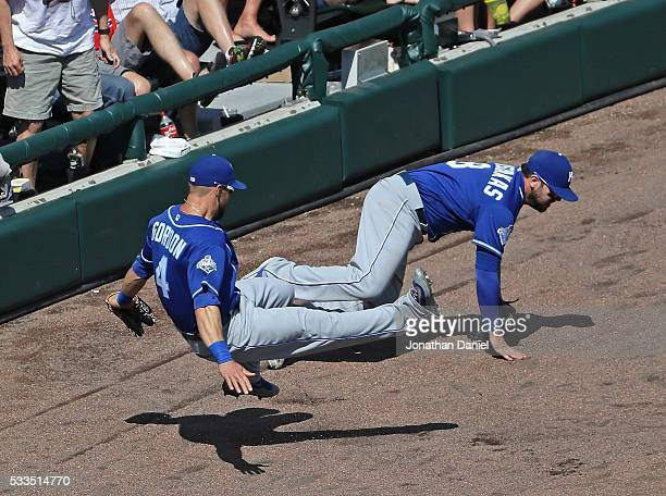 Alex Gordon and Mike Moustakas of the Kansas City Royals collide going for a foul ball against the Chicago White Sox at US Cellular Field on May 22...