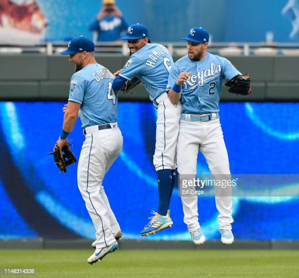 Alex Gordon Billy Hamilton and Chris Owings of the Kansas City Royals celebrate a 32 win over the Tampa Bay Rays during the first game of a...