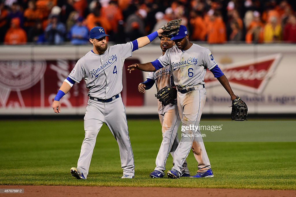 Alex Gordon #4, Jarrod Dyson #1 and Lorenzo Cain #6 of the Kansas City Royals celebrate defeat the Baltimore Orioles 6 to 4 in Game Two of the American League Championship Series at Oriole Park at Camden Yards on October 11, 2014 in Baltimore, Maryland.