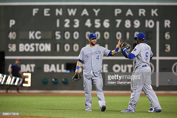 Alex Gordon Lorenzo Cain and Jarrod Dyson of the Kansas City Royals high five eachother after their victory over the Boston Red Sox on August 26 2016...