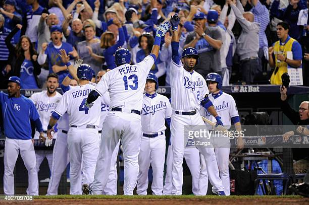 Alex Gordon of the Kansas City Royals and Salvador Perez of the Kansas City Royals celebrate with teammates after scoring runs in the fifth inning...