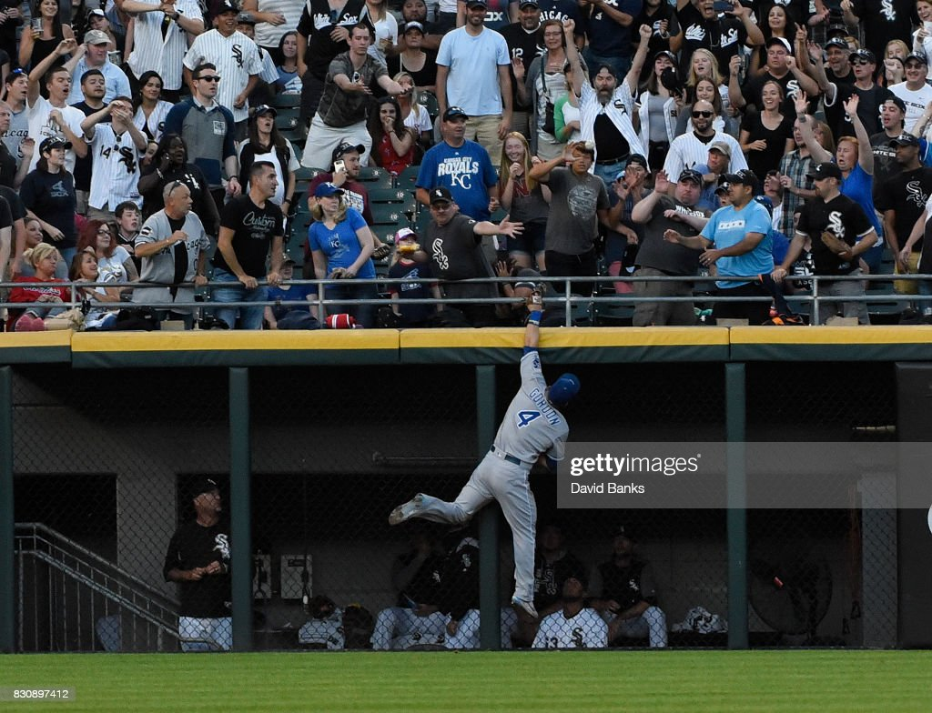 Alex Gordon #4 of the Kansas City Royals can't catch a home run hit by Jose Abreu #79 of the Chicago White Sox during the fourth inning on August 12, 2017 at Guaranteed Rate Field in Chicago, Illinois.