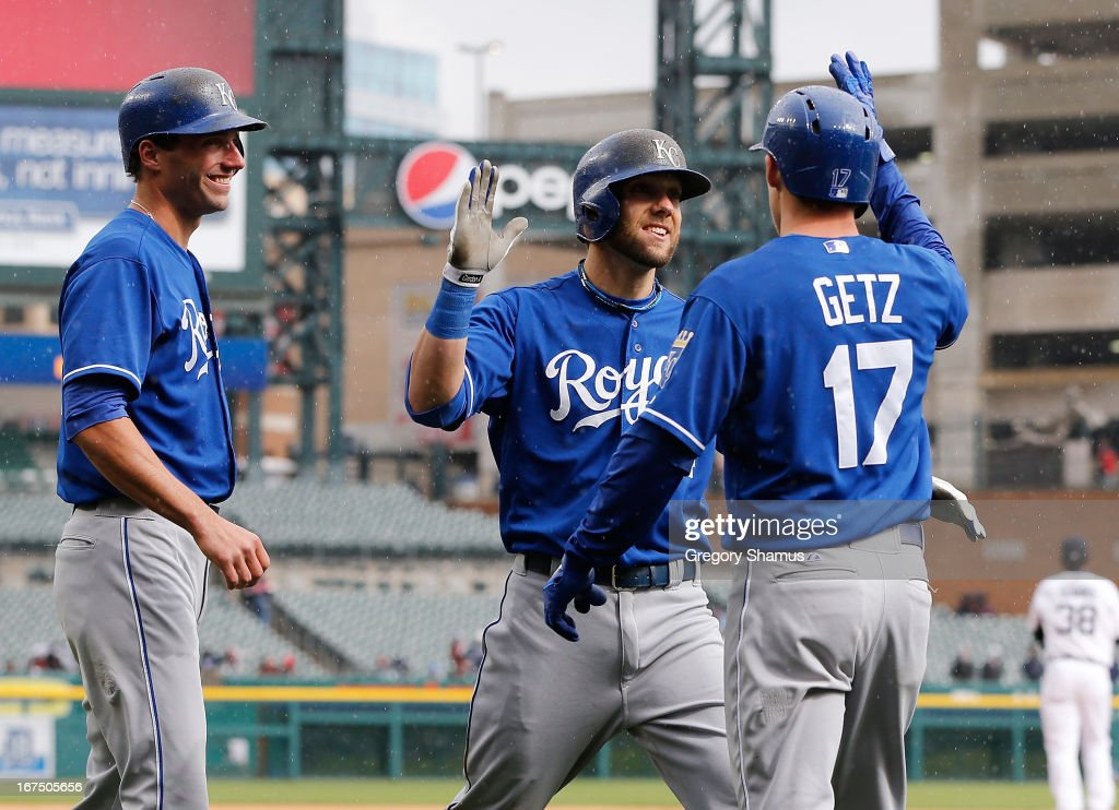 Alex Gordon #4 of the Kansas City Royals celebrates his 10th inning grand slam with Chris Getz #17 and Jeff Francoeur #21 while playing the Detroit Tigers at Comerica Park on April 25, 2013 in Detroit, Michigan. Kansas City won the game 8-3.