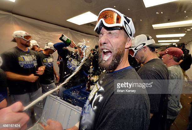 Alex Gordon of the Kansas City Royals celebrates in the locker room with his teammates after the defeating the Chicago White Sox to clinch a wildcard...