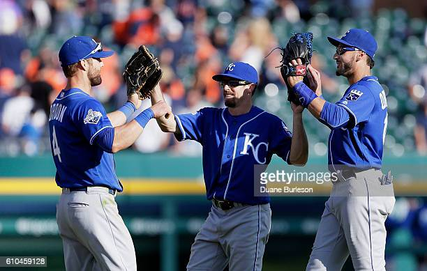 Alex Gordon of the Kansas City Royals celebrates with Billy Burns of the Kansas City Royals and Paulo Orlando of the Kansas City Royals after a 129...