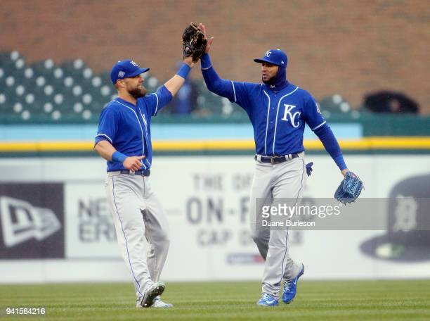 Alex Gordon of the Kansas City Royals celebrates with Paulo Orlando after a 1-0 win over the Detroit Tigers at Comerica Park on April 3, 2018 in...