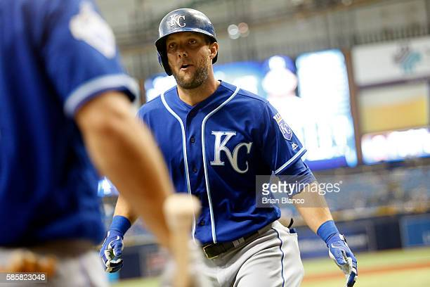 Alex Gordon of the Kansas City Royals celebrates with teammate Billy Burns after hitting a tworun home run off of pitcher Drew Smyly of the Tampa Bay...