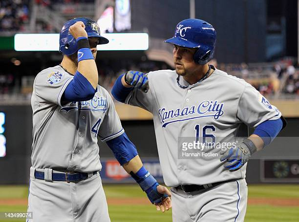 Alex Gordon of the Kansas City Royals congratulates Billy Butler on a two run home run against the Minnesota Twins during the third inning on April...