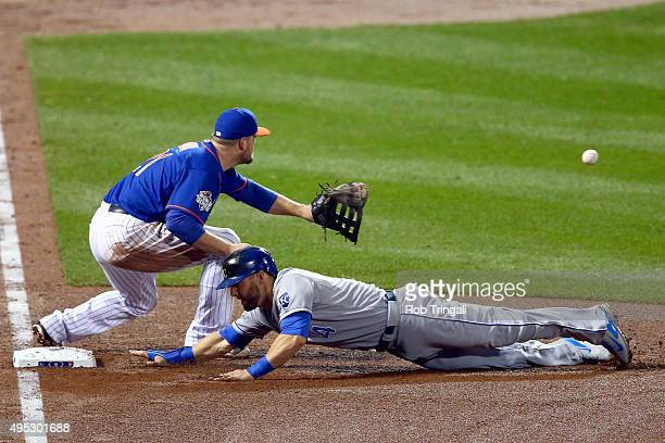Alex Gordon of the Kansas City Royals dives back to first as Lucas Duda of the New York Mets waits for the throw during Game 5 of the 2015 World...