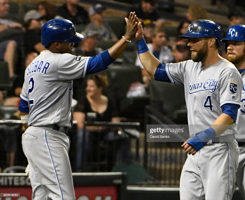 Alex Gordon #4 of the Kansas City Royals greets Alcides Escobar #2 after scoring against the Chicago White Sox during the seventh inning on September 23, 2017 at Guaranteed Rate Field in Chicago, Illinois.