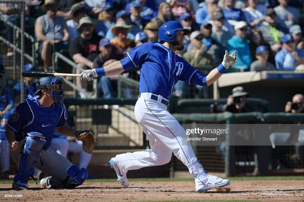 Alex Gordon #4 of the Kansas City Royals hits an RBI double in the first inning Los Angeles Dodgers at Surprise Stadium on February 24, 2018 in Surprise, Arizona.