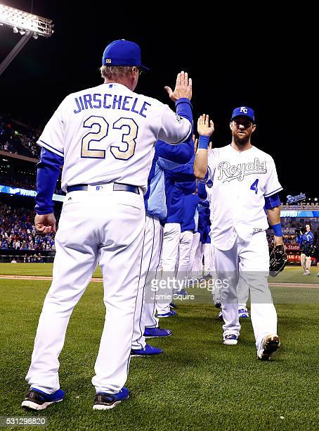 Alex Gordon of the Kansas City Royals is congratulated by third base coach Mike Jirschele as he walks off the field after the Royals defeated the...
