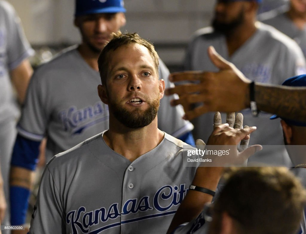 Alex Gordon #4 of the Kansas City Royals is greeted by his teammates after hitting a home run against the Chicago White Sox during the fifth inning on September 23, 2017 at Guaranteed Rate Field in Chicago, Illinois.