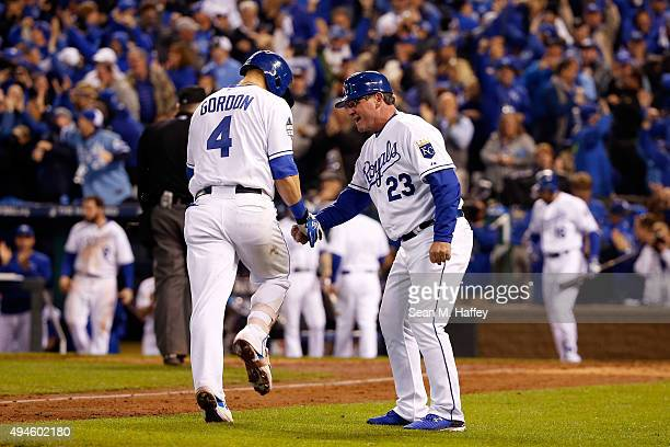 Alex Gordon of the Kansas City Royals is greeted by Mike Jirschele of the Kansas City Royals after hitting a solo home run in the ninth inning...
