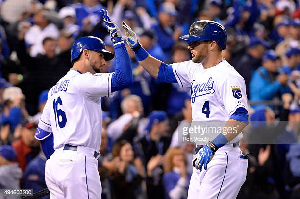 Alex Gordon of the Kansas City Royals is greeted by teammate Paulo Orlando after hitting a game tying home run in the bottom of the ninth inning of...